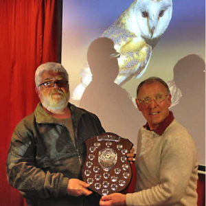 Larry Bedigan (left) is awarded the shield for the top scoring photograph by judge David Stout (right) for his splendid image 'Barn Owl' shown in the background